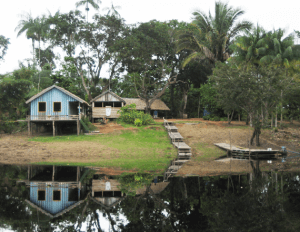 houses in the Amazon next to a river