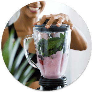 woman making smoothie in blender